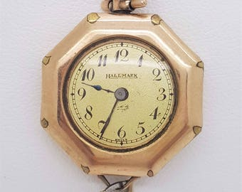 A vintage ladies Hallmark 14k rose and yellow gold wrist watch Swiss made