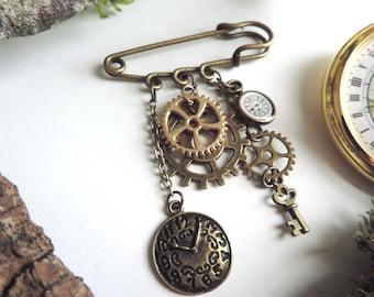 Bronze steampunk brooch: key, clock gears (bronze, silver and gold)
