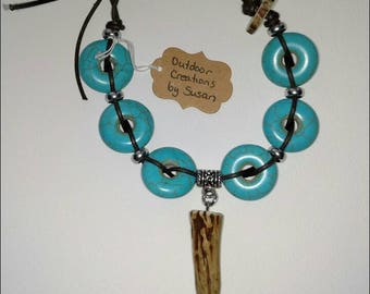 Turquoise bracelet with genuine whitetail deer antler tip and slice for clasp.