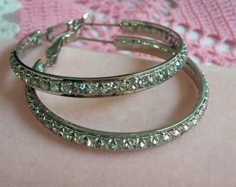 Vintage silver rhinestone hoop earrings signed Joy