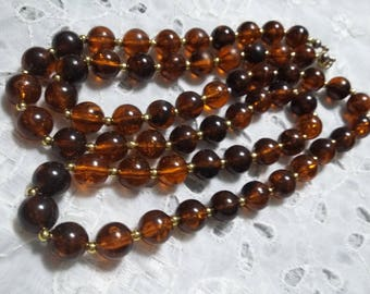 Vintage Root colored beer plastic beaded necklace 30 inches