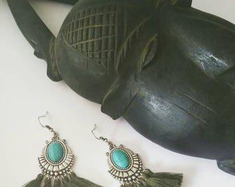 Ethnic boho earrings, faux turquoise bezel and kakhi tassels.