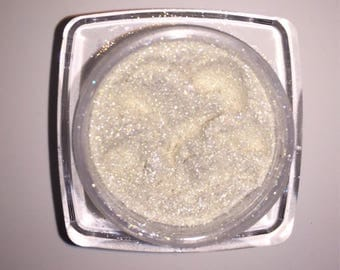 Prism Powder ( White Lies ). White pearl that shifts gold. Loose highlighting powder for face and body. Vegan and cruelty free.
