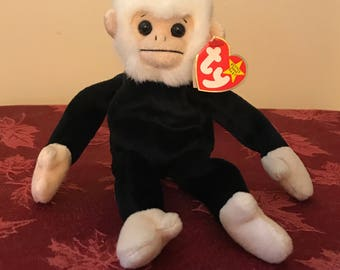 Ty Beanie Baby Mooch with different year dates on swing and tush tag error
