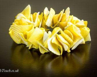 Stretch natural sea shell bracelet.
