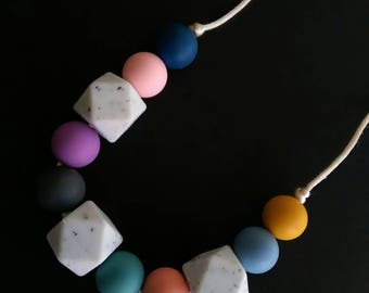 Brighten up winter with this gorgeous necklace with jewel toned round silicone beads and granite feature beads.
