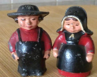 Vintage Cast Iron Amish Man and Woman Corked Salt and Pepper Shakers