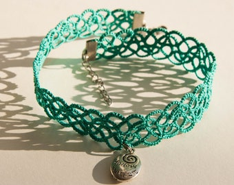 A mint tatted choker with metal pendant