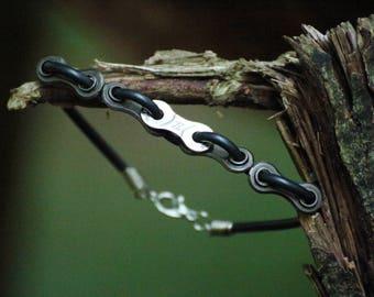 Rubber biker bracelet made of an used bike chain