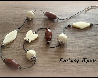 A necklace on black cord, chocolate and creamy white pearls.