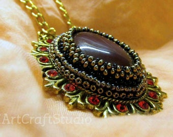 Golden red agate pendant