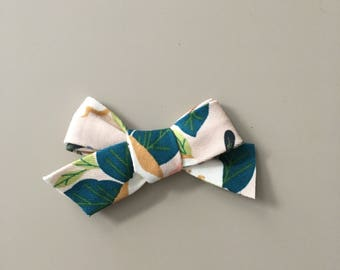 Floral fabric bow on one size fits most nylon headband OR alligator clip