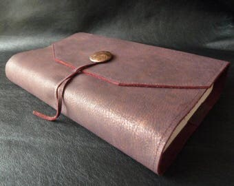 23 cm tall books, book adaptable in plum leather with brass reliefs, closure strap and room decoration