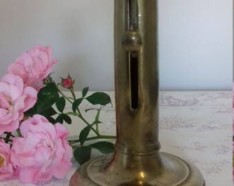 Push the 19th century brass candlestick
