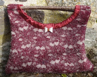 Felted lace handbag