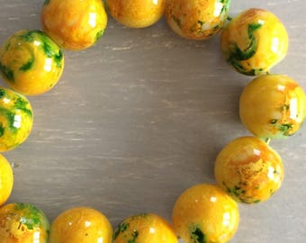 Yellow spray painted glass beads
