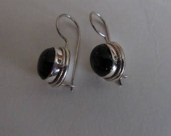 silver earring with onyx