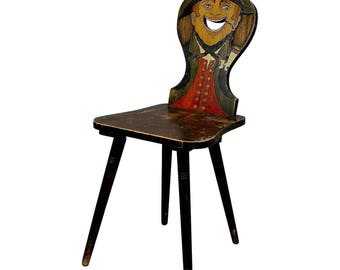 a carved and painted folksy chair ca. 1910
