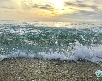 Sunrise waves rolling on Juno Beach