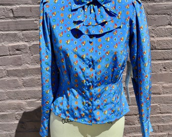 Chaus Petites blue long sleeve button up blouse with playful birds