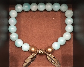 Jade and Gold bead with leaf accent