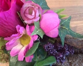 Flower arrangement on tree bark