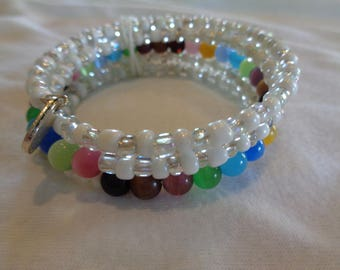 Memory Wire Bracelet with clear and white seed beads and multi-colored accents,