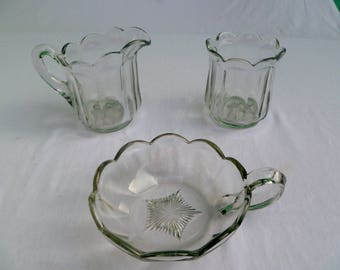 vintage pressed glass set of cream, sugar, and candy dish with starburst pattern