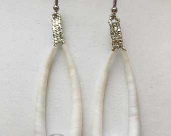 Native American made silver and dentalium shells.