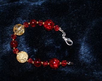 Yellow and red glass beaded bracelet
