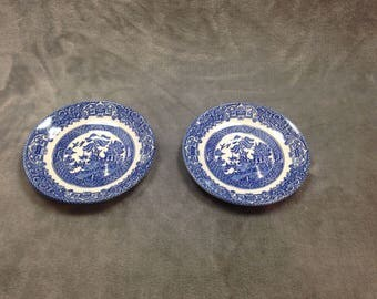 Pair of two traditional Willow Pattern saucers