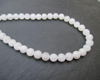 Transparent white Moonstone: 15 round beads 6 mm.