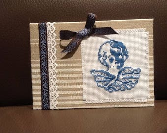 Blue Angel on ticking embroidery frame