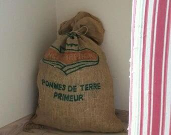 Burlap trimmed straw bag