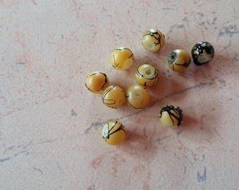 Yellow marbled black 6mm round glass beads