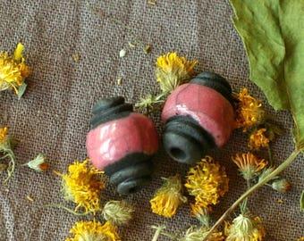 Set of 2 beads pink and black raku pottery