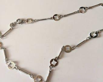 flat silver metal chain,