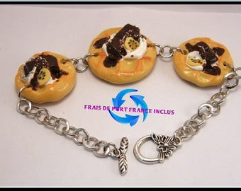 Embossed chocolate/whipped cream polymer clay and silver chain bracelet.