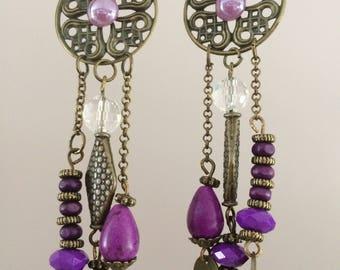 Purple beads and bronze earrings