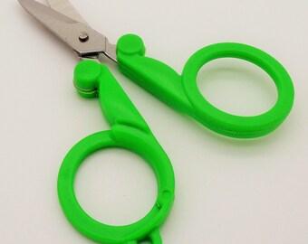 Green folding scissors