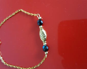 gold chain with beads and charm bracelet
