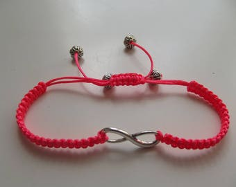 Bracelet in salmon color with an infinite polyester.