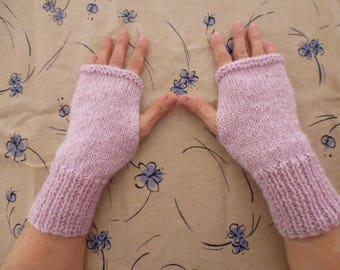 Hand knitted pink women gloves