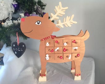 Wooden advent calendar. Red-Nosed Reindeer. Christmas