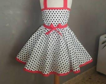 White cotton dress with polka dots.
