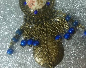 Great ethical bronze pendant and its lovely blue glass beads