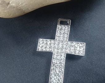 A large cross with clear rhinestones connector