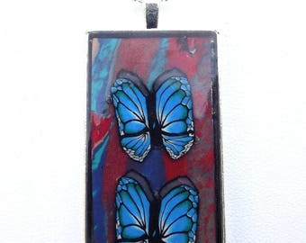 Necklace: Blue butterflies on 925 silver plated.