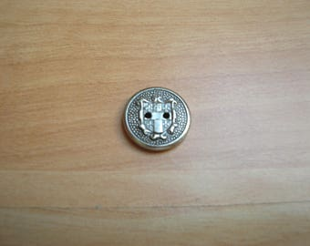 round shape of Blazon with metal button