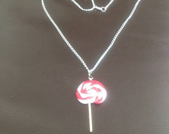 Red and white candy cane shaped necklace